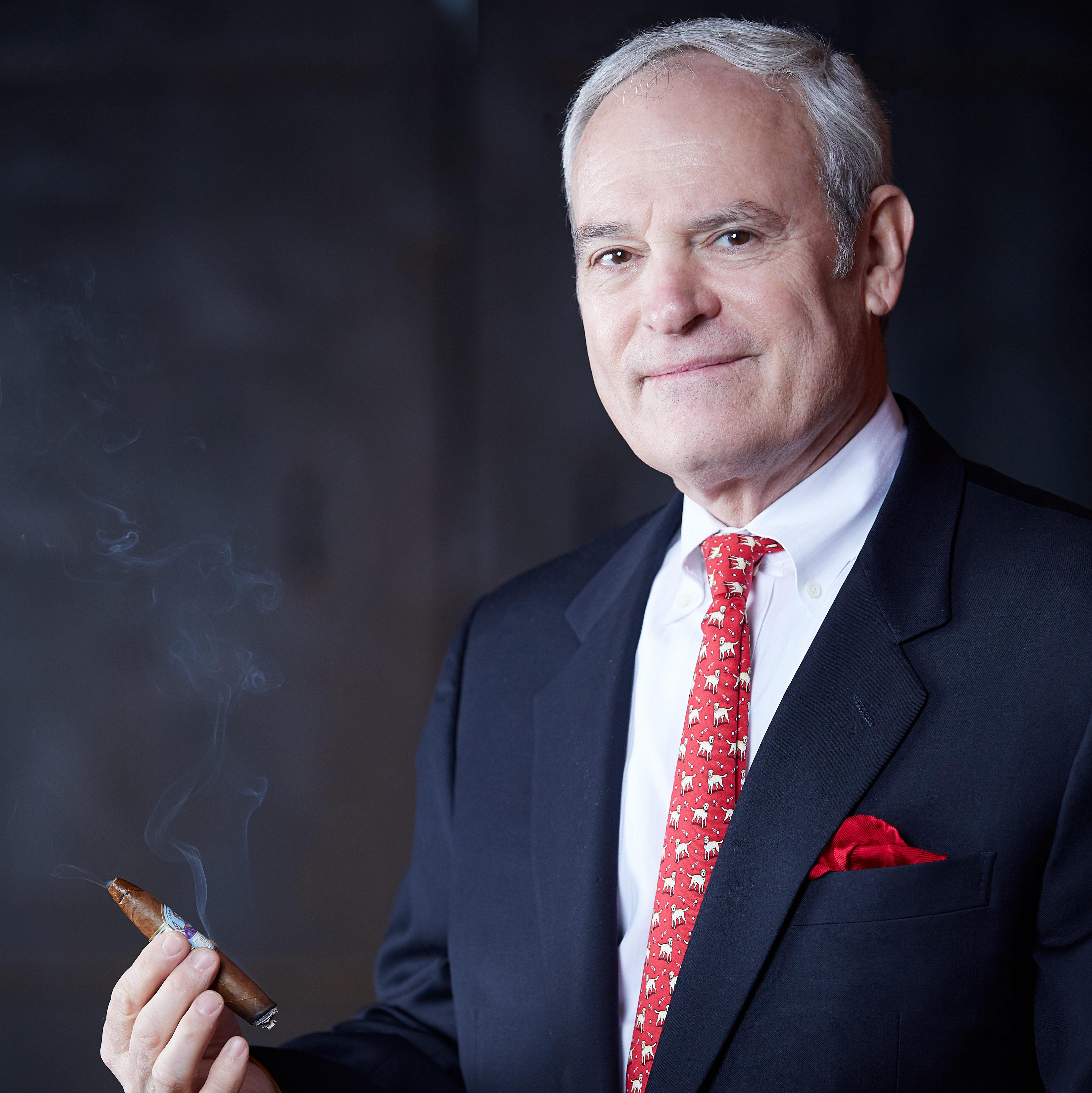Bobby Newman third Generation Headshot holding Julius Caeser Cigar