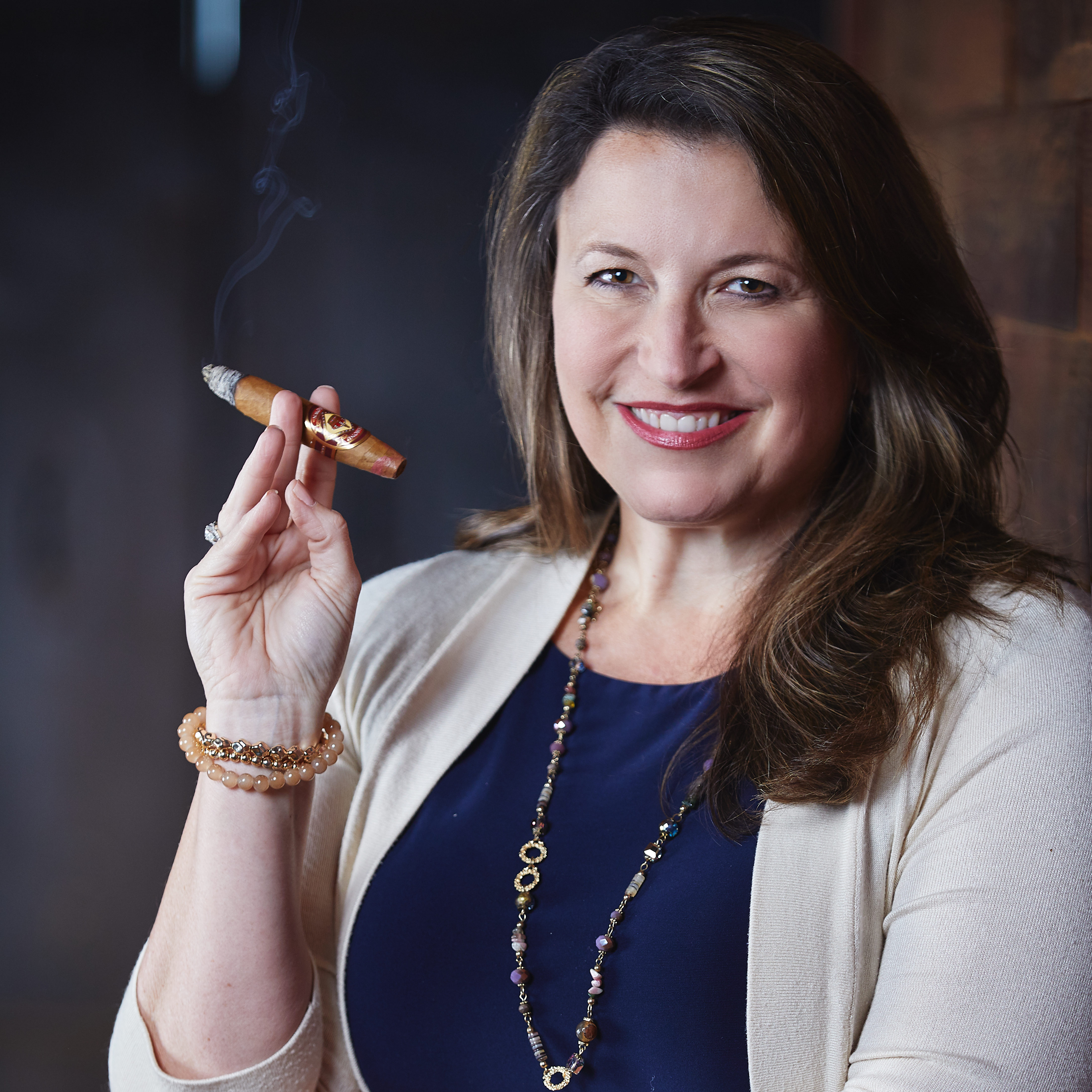 Cristal Blackwell-Lastra Holding Diamond Crown Cigar