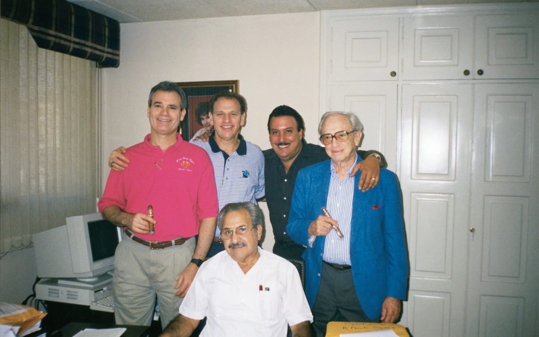 Drew Eric and Stanford Newman with Carlos and Carlos Jr. Fuente