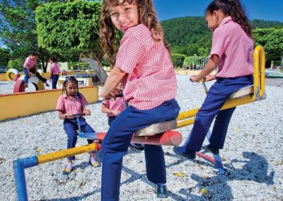 Students in Domincan Republic on SeeSaws