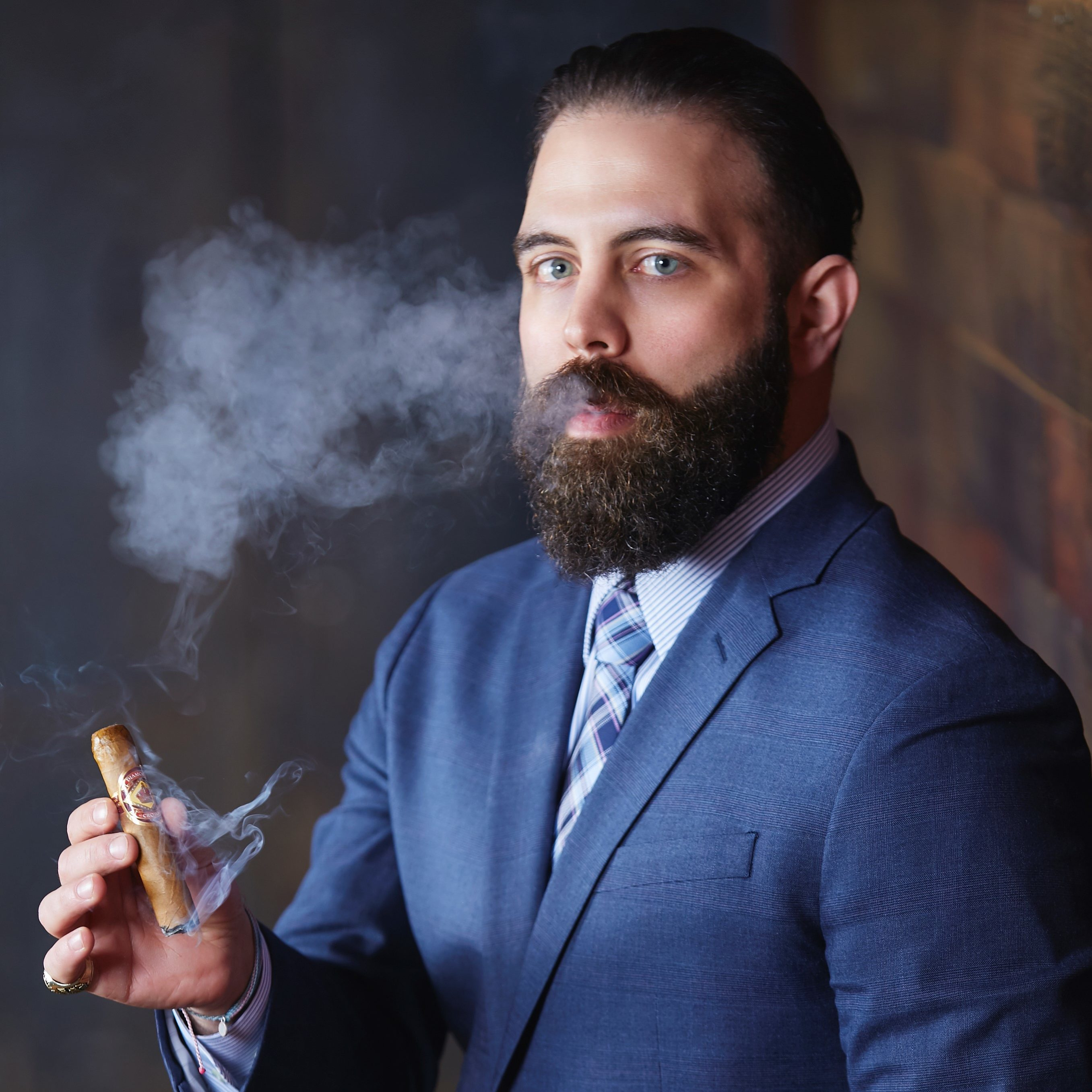 Anthony Sariyan holding Diamond Crown Cigar Regional Sales Manager
