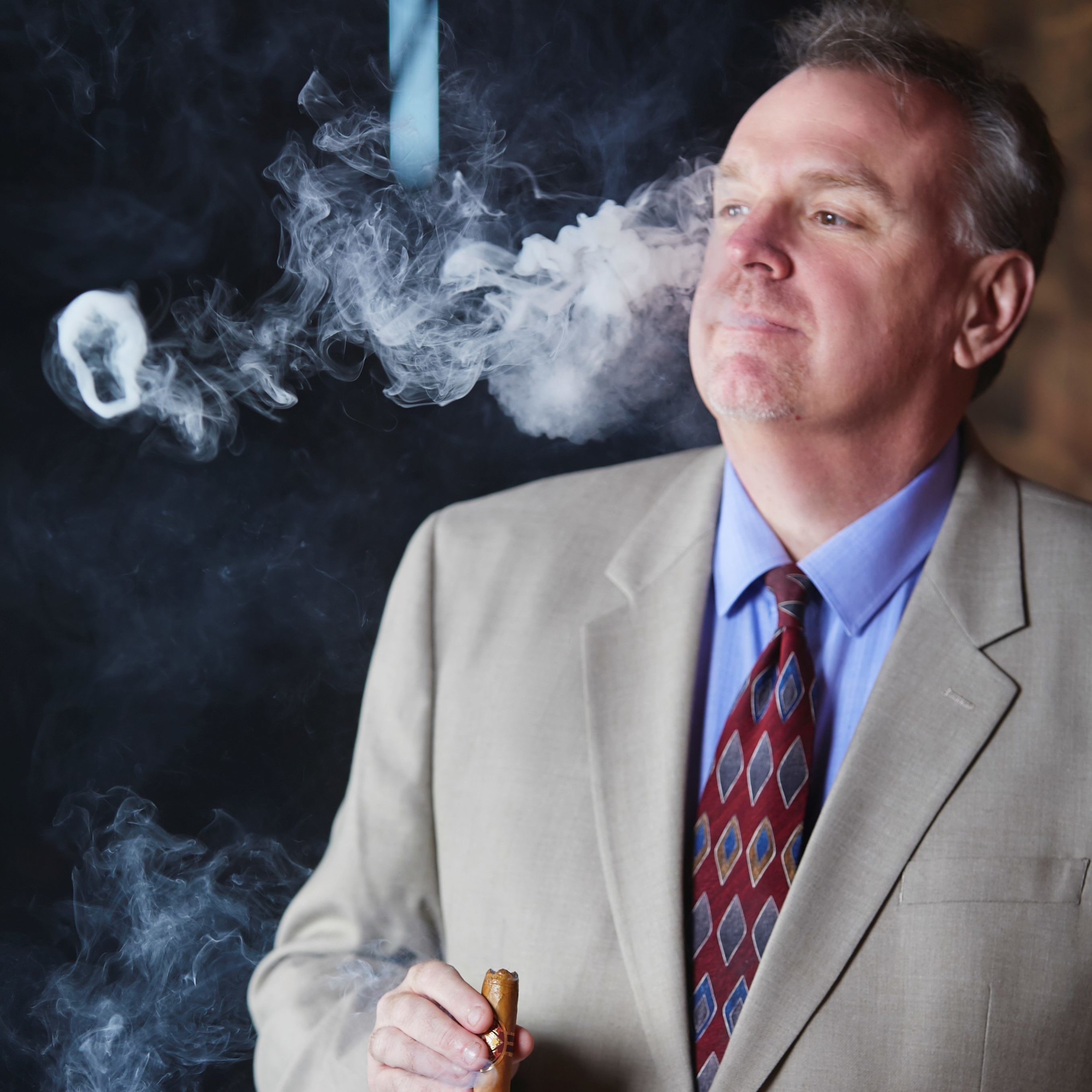 Dan LeBold smoking Diamond Crown Cigar Regional Sales Manager