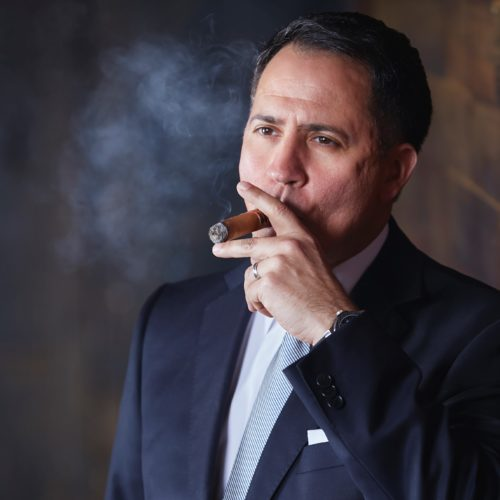 David Lugwig smoking Diamond Crown Cigar Regional Sales Manager