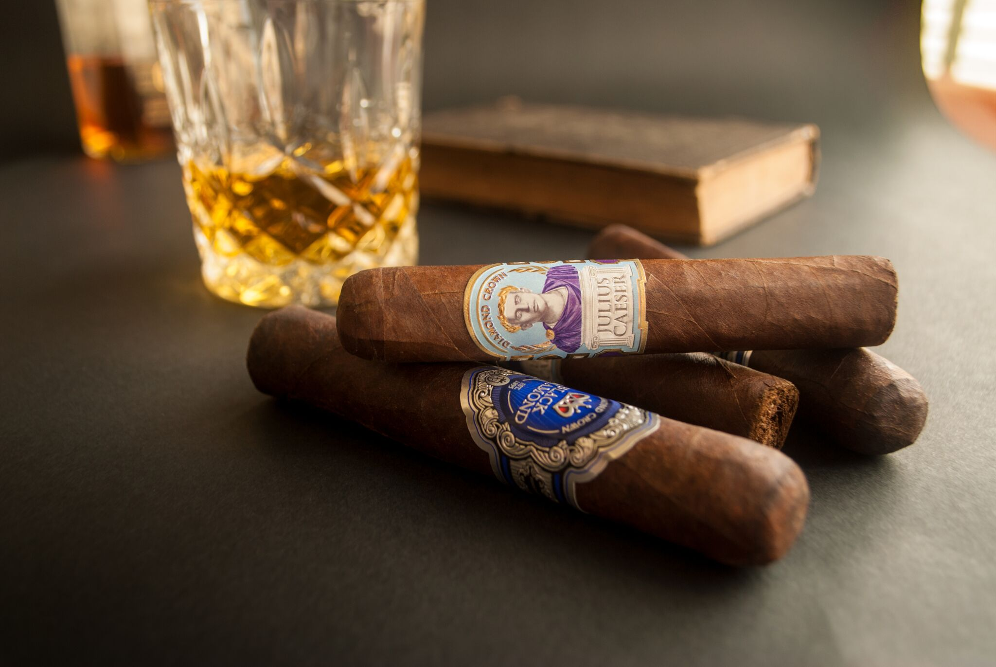 4 diamond crown cigars with glass of whiskey