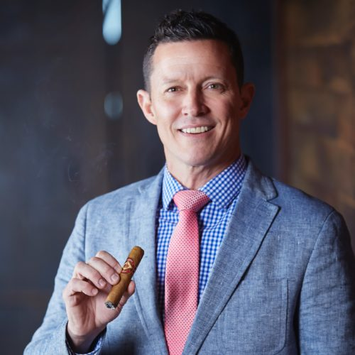 Sean Poza holding Diamond Crown Cigar Regional Sales Manager