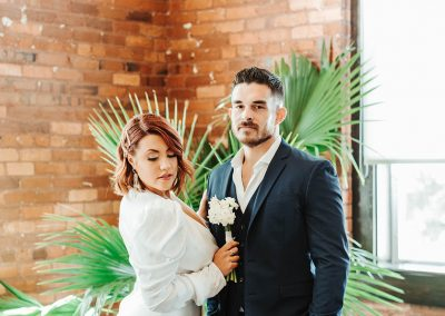 bride and groom in front of plant at jc newman cigar company factory tampa